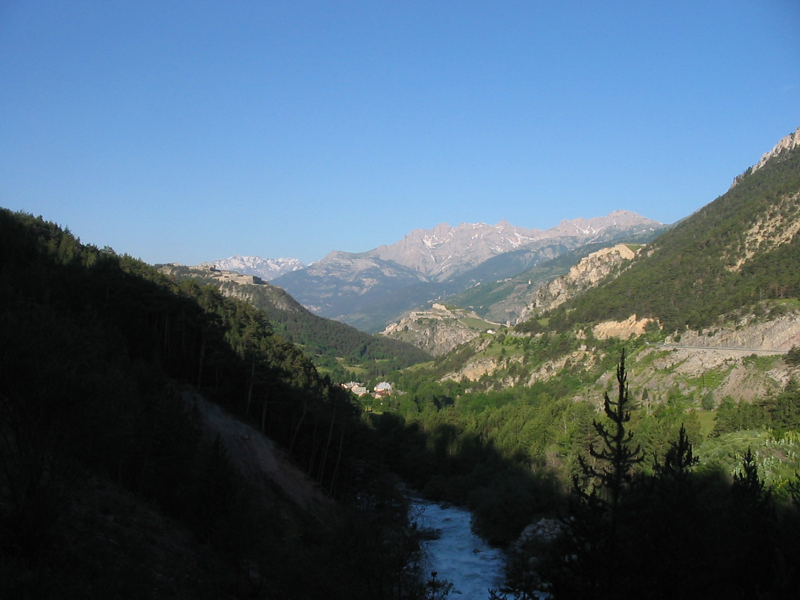 Photo de Briançon atop a hillock in the midst of its valley